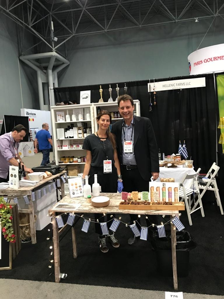 Vivianna Karamanis, founder of Hellenic Farms, with her husband, Theophilos Tziotis, beam with pride at a display of Hellenic Farms Products